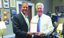 Mick Miller with DENCO II presents Rep. Collin Peterson with a Growth Energy award for his outstanding leadership and support of the Biofuels Industry.