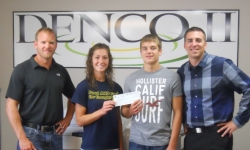 Mick Miller-DENCO II General Manager, and Bryce Jones of Growth Energy present a check to MAHS FFA members Rachel Moser and Tony Domnick. FFA members will be competing in the National competion in October with their presentation of